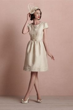 A sophisticated silhouette for an unconventional bride. Silk-cotton twinkles with intricate floral beading while an open back and a knee-length hemline add just the right amount of daring and dash. A Hitherto original, available exclusively from BHLDN. Side zip closure; removable grosgrain belt fastens with a hook-and-eye. Dry clean. Imported.