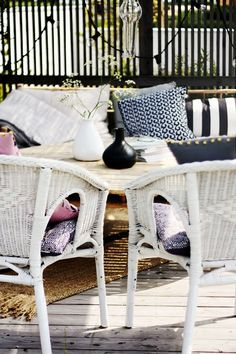 love the navy color and patterns with the white wicker