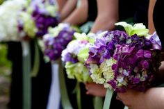 bouquets of light green and purple flowers - photo by Seattle based wedding photographers La Vie Photography