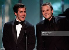 Actor Jake Gyllenhaal and Heath Ledger speak onstage during the 12th Annual Screen Actors Guild Awards held at the Shrine Auditorium on (January 29, 2006) in Los Angeles, California.