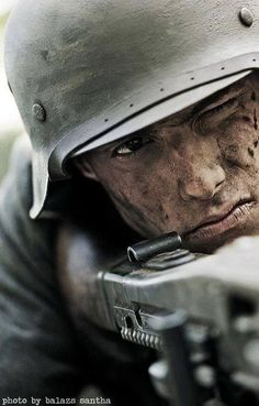 """CAVEAT: Though frequently posted here as """"Stalingrad 1943 German soldier"""" or the like, this is a modern re-enactment plainly credited to Hungarian photographer Balasz Santha at the bottom. It is not a genuine wartime image."""