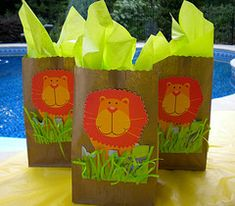 I bought extra lion king invitations and cut out the lion to use on the party favor bags. Glued the lion and some green grass to brown paper lunch bags. Use bright green tissue paper for added color.