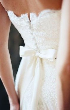 Strapless lace wedding dress with bow detailing
