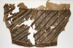 Egypt - Textile fragment from a trouser leg (sirwal) Mamluk Period (1250 - 1517) Linen, embroidery in pattern darning with madder red (medium and dark), and blue silk; with seam and hem sewn in flax.