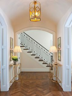 Herringbone wood flooring in a #traditional #foyer #entry. That floor is absolutely gorgeous!