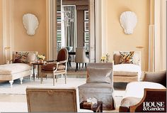 love this neutral room with the leather louis chair