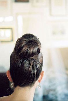 Brides.com: Wedding Hairstyles for Straight Hair. Sleek High Bun Wedding Hairstyle. Choose a sky-high bun to show off your beautiful features. Keep it slicked back into the night with pins and pomade.   Browse more classic wedding hairstyles.