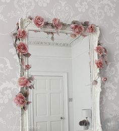 Room with wallpaper, shabby chic crown molding, and a beautiful framed mirror. #white