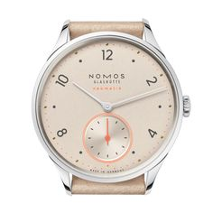 NOMOS Glashutte Minimatik Champagne timepiece is presented on a beige leather strap. The case encases a champagne gold dial with numeral hour markers and silver hands. This watch features a NOMOS calibre DUW 3001 automatic movement with a 43 hour Time And Tide, Cyan Blue, Blue Accents, Beautiful Watches, Watch Case, Automatic Watch, Cowhide Leather, Luxury Watches, Watches For Men