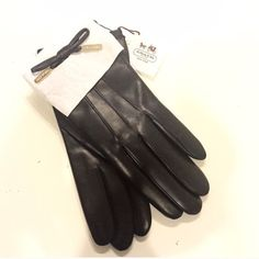 Coach black leather & cashmere gloves ❄️☃ Brand new size 6.5 Coach black leather gloves. Bought on posh but they don't fit me  Made for smaller hands than mine. They are beautiful and buttery soft leather. Cozy and warm cashmere on the inside. Adorable bows with gold Coach logo on face of hand side... ☃ Stay warm & cute!!  Comes with Coach bag seen in pic :) Coach Accessories Gloves & Mittens
