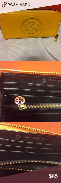 Tory Burch yellow leather wallet. Tory Burch yellow patent leather wallet with the signature double T's in a circle on the front, the zipper covers 3/4 of the wallet with a metal Tory Burch zipper pull, inside is 3 sections for cash, cards and coins there are 8 CC slots and a signature gold metal Tory Burch zipper pull the wallet is in excellent condition no damage, rips or tears on the back are a few pen marks other than that this is a awesome wallet. Tory Burch Bags Wallets