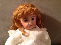 Hand-wefted doll wig in strawberry blond.  Exposed part and bangs.