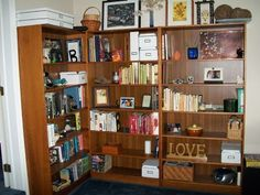 """These shelves represent how marriage brings two lives and two people with very different interests together harmoniously. They showcase my husband's love of fantasy books alongside my passion for children's literature. Other interests are on display here as well: his love of music, Deloreans, and Redskins football, and my interest in nature, the classics, and a weakness for Ikea's organizational tools. Every item on the shelves helps tell our life story, both as individuals and together..."""