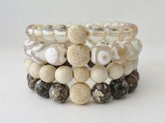 Beaded stack bracelet, gemstone, stretch, brown, tan, white, cream, 14k gold filled, stardust, stackable, beaded bracelet, white tibetan by MarciaHDesigns on Etsy https://www.etsy.com/listing/264466011/beaded-stack-bracelet-gemstone-stretch
