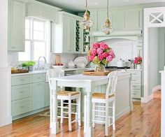 cute green kitchen.  I don't know if I'm gutsy enough to do this color, though!  Love the lantern lighting and layout of kitchen.