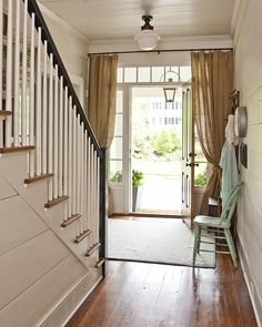 Covering windows that frame door....what a clever way to use drapes