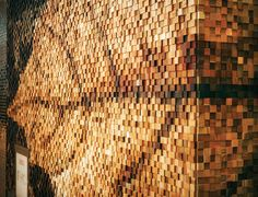 The front facade and entrance is a mosaic crafted from 35,788 wooden blocks made from a variety of woods salvaged from the collected history of the Brothers Dressler workshop. Inspired by our photograph of a fallen leaf, the palette is comprised of all the natural colours of these woods pixelated into the image. This mosaic embodies the history of these woods from tree to beam to stave to lumber and everything in between.