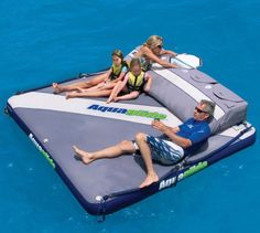 The giant floating mattress is a large inflatable mattress looking device where you and your family can lounge about on the lake and drink beer and grape juice, and enjoy life where it is meant to be enjoyed, on a mattress.
