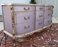 Purple dresser with gold highlights