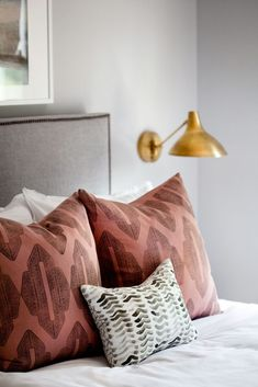 An Inviting Guest Bedroom With A Soft Color Palette Of Gray Blue, A Mix Of  Textiles, And Antique Rubbed Brass Sconces To Create Warmth.