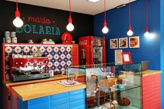 As warm and colorful as their homemade cakes is the interior of this small bakery in Brazil. Though the space is limited to just six tables, the rich detail and bold hues will make you feel like you're in a dollhouse, living a happy life with sweets.