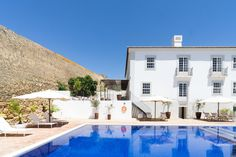 In the sunny south of Portugal, we found this abandoned estate by the sea and turned it into our dream holiday casa. Hotels In Portugal, Spain And Portugal, Next Holiday, Beach Bars, Restaurant, Jackson Hole, Modern Buildings, Algarve, Bunker
