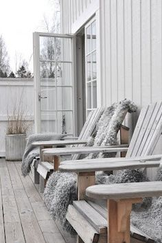 Adirondack chairs lined up, wonderfully weathered teak