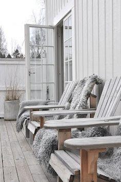 Adirondack chairs lined up, wonderfully weathered teak