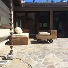 Outdoor furniture built with recycled redwood fencing.