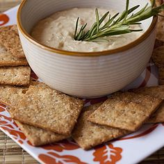 4 whole-grain crackers spread with 1 tablespoon hummus  Complex carbohydrates such as whole grains and beans are some of the best energy boosters out there, and can fill you up without making you sluggish. Hummus, a spread made from garbanzo beans, contributes fiber and a little olive oil, both of which help satiate hunger pangs.