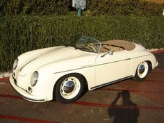 cream on tan 1957 PORSCHE SPEEDSTER ......wish i had this in my 3rd garage bay instead of what's actually sitting there.......hehe