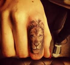 Awesome lion tattoo.  Can't believe the artist got that much detail on a woman's finger.