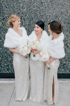 sparkly gold dresses with fur stoles for winter bridesmaids