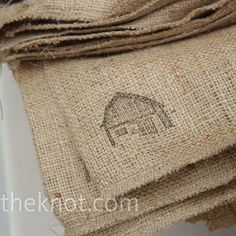 Burlap sacks stamped with wedding logo for guests to carry home their favors (local produce - heirloom tomatoes and bell peppers)