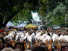 University of Southern Mississippi Golden Eagles. Fans line the streets for the Eagle Walk parade, held two hours before kickoff. The Southern Miss cannon fires to begin the fun.