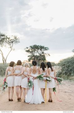 Long wedding dress with open back and lace detailing and bridesmaids in short cream dreses Hair Jewelry, Jewellery, Our Wedding, Wedding Venues, Bridesmaids, Bridesmaid Dresses, Long Wedding Dresses, Got Married, Bordeaux