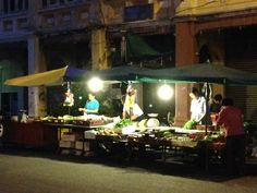 Early morning Penang. Before sunrise, market workers setting up for the day's trading in Georgetown.
