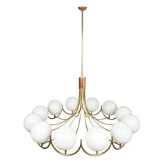 View this item and discover similar for sale at - A large American brass chandelier. Elegant brass tubing flows to hold 12 white glass globes with a copper center fitting. Large Chandeliers, Chandelier Pendant Lights, Modern Chandelier, Glass Globe, Light Table, Interior Lighting, Light Up, Ceiling Lights, American