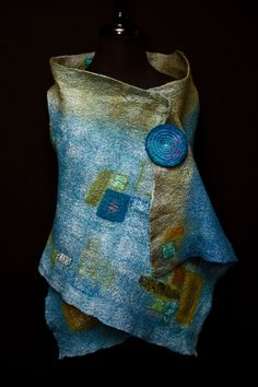 Eire vest - hand felted merino wool and hand dyed silks/with felt pin of Corriedale wool with stitching Instragram:  jsfiberarts