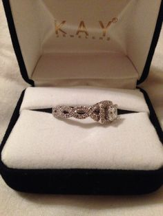 Neil Lane engagement ring, LOVE the band, don't care for the shape if the stone though
