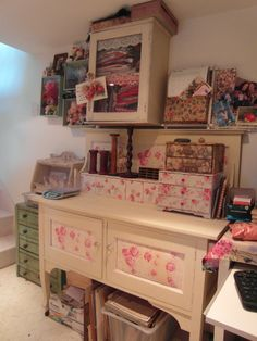My workroom - love the cloth panel doors on the dresser