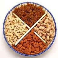 A reusable fruit basket filled with the best of goanese cashews, almonds, pistachios and raisons. Net weight: 1 kg Engagement Gift Baskets, Engagement Gifts, Dry Fruit Basket, Sweet Hampers, Pistachios, Almonds, Wish Gifts, Diwali Gifts, Indian Sweets