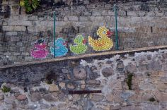 These Colorful Cross-Stitch Murals Are The Last Thing You'd Expect From A Graffiti Artist