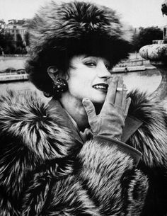 Loulou de la Falaise in a Saint Laurent fur  photographed in Paris on Pont Alexander III.  Photo by Andre Leon Talley.  Vanity Fair, March 1987.