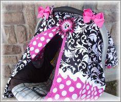 Damask and Polka Dot Carseat Canopy  Be in style with this adorable carseat cover!!!    No more big bulky blankets that can get caught and torn off by the wind. This carseat cover is attatched to your carseat by straps. They are great to keep the germs off your little one especially through flu season. Also great for keeping the wind, sun and rain off your little one. You will also look great sporting around this carseat and you wont believe the compliments you will recieve.