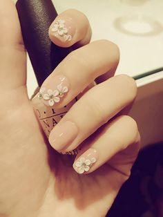 3D petals nail art over nude nails