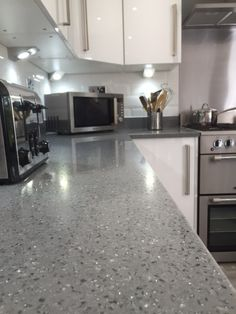 Grey Supanova Quartz Grey Supanova is a gorgeous light grey quartz encrusted with crystals and finis Gray Kitchen Countertops, Gray Quartz Countertops, Kitchen Benchtops, Granite Worktops, Kitsch, Stone Benchtop, Light Grey Kitchens, Grey Kitchen Designs, Stone Kitchen