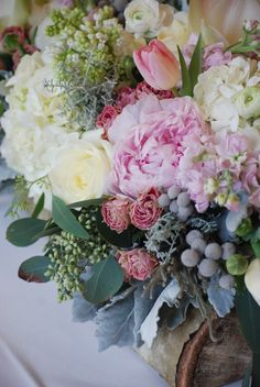 Rustic Chic Arrangement in an Aspen Log. Hydrangea, Peonies, Ranunculus, Tulips, Brunia Berries, Dusty Miller