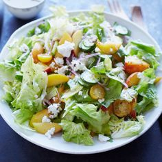 In her terrific salad, author Anya von Bremzen combines escarole and feta with a refreshing dressing; firm, just-ripe peaches add lovely sweetness.