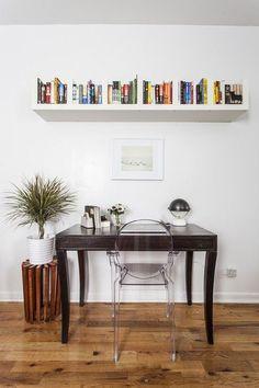 Contemporary Work Space: A floating bookshelf over a simple desk workspace .